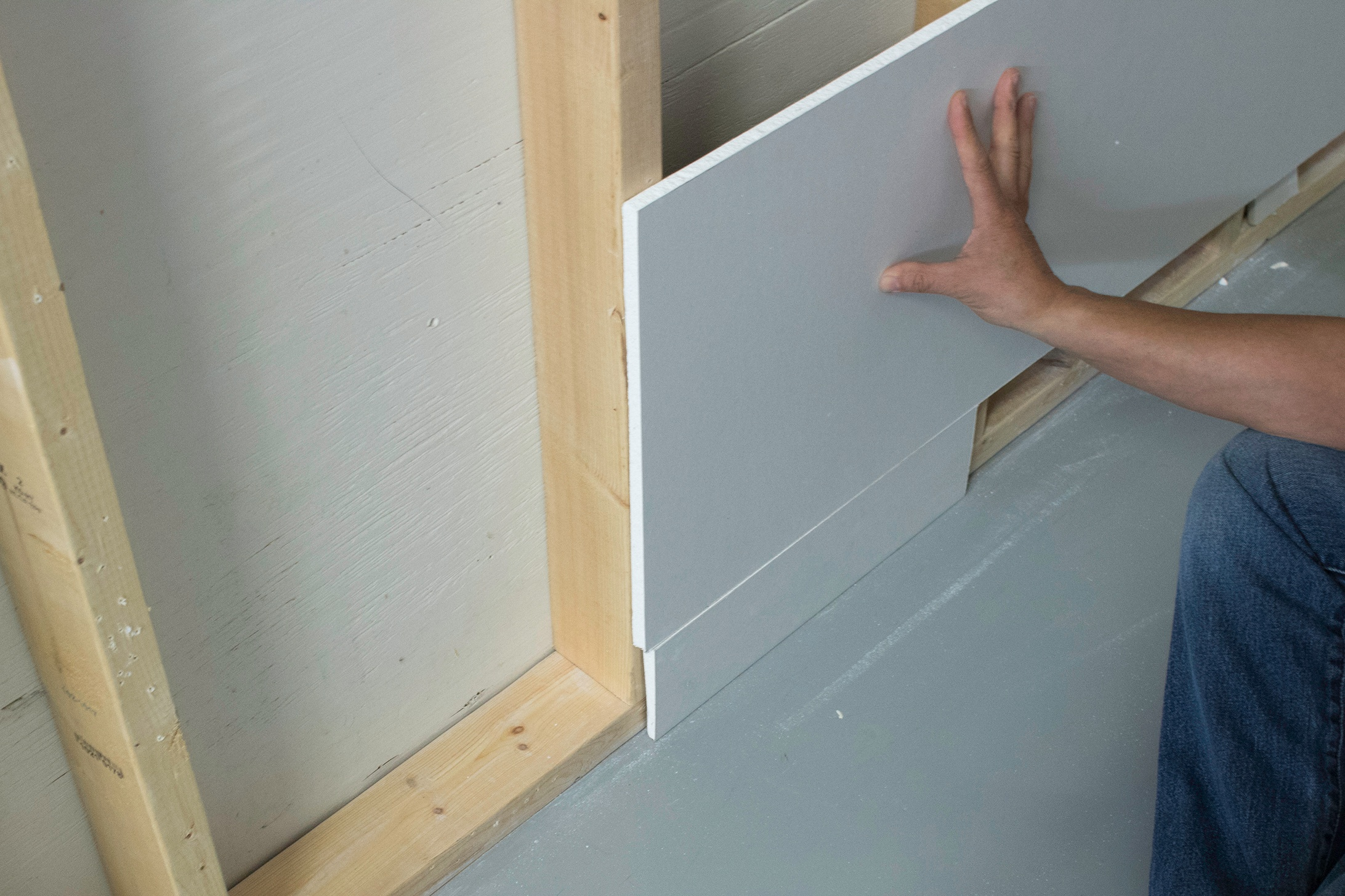 Once baseboard height is determine, take a scrap piece of drywall to act as a guide when installing the drywall to ensure adequate room for baseboard.