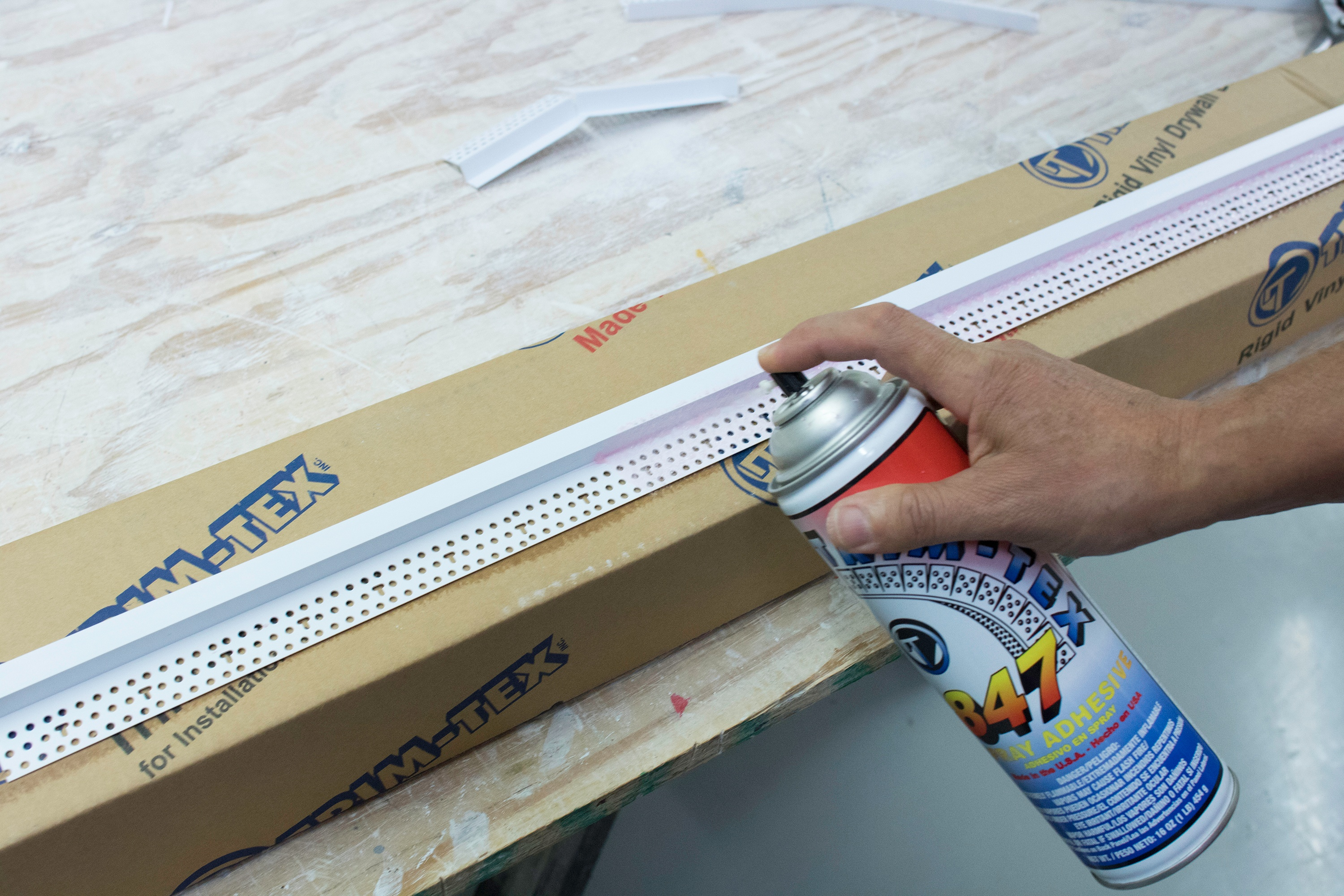Apply two coats of 847 Spray Adhesive directly to Architectural Z Shadow Bead for baseboard installation.