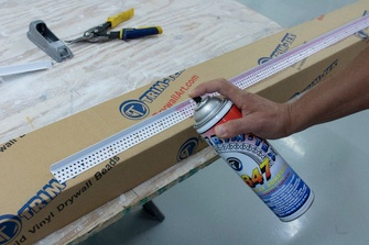 It is recommended to apply two coats of 847 Spray Adhesive directly to Architectural L Bead.