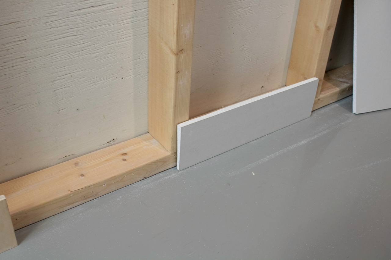 Create a spacer from a piece of drywall to act as a guide when installing the drywall.