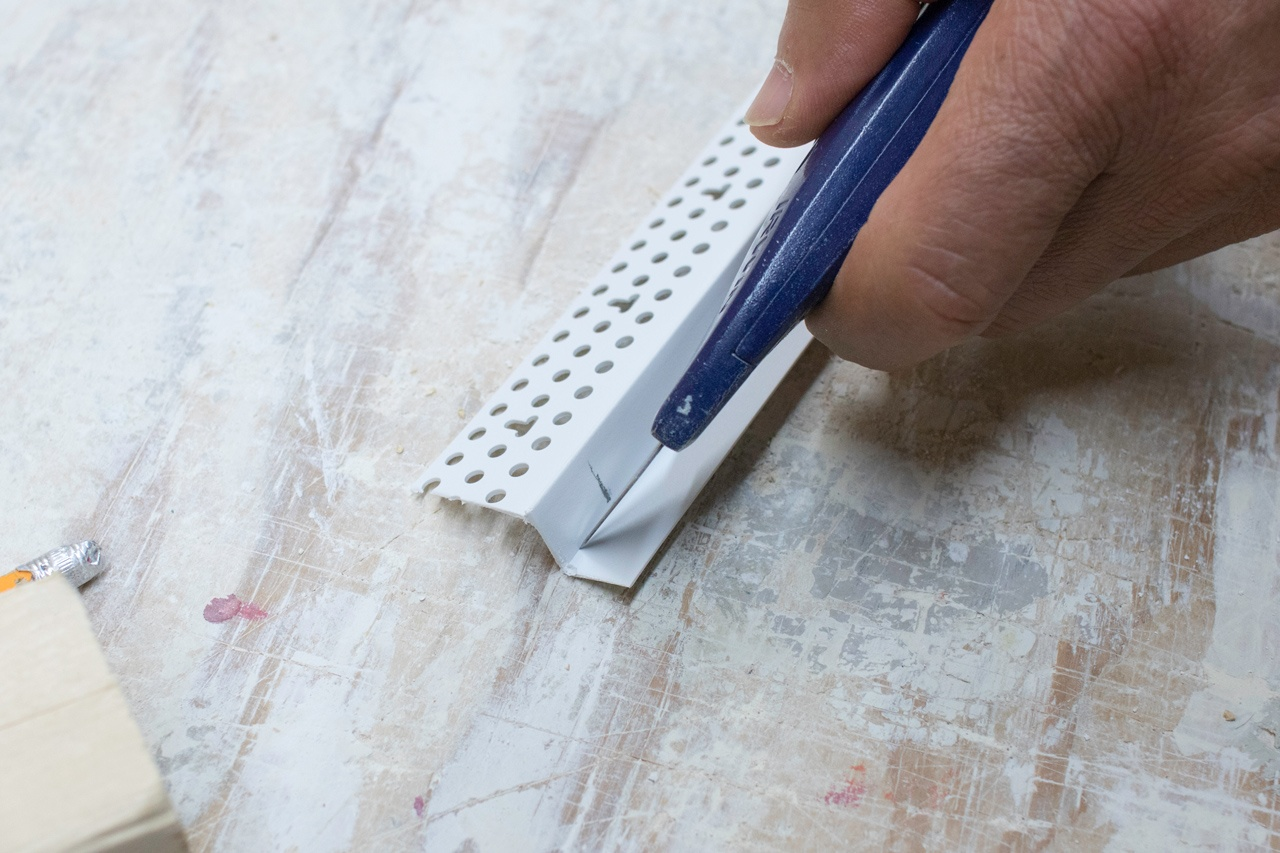 Score the center of the return leg with a utility knife.