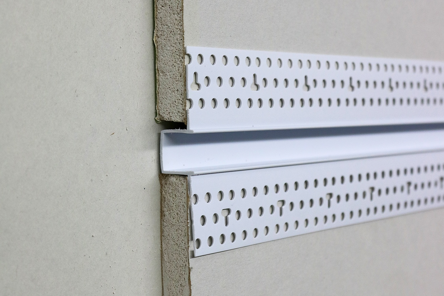 "When hanging your drywall or cutting slots to place reveals into, make sure to allow for 1/16"" gap between the drywall and the recessed section of the reveal."