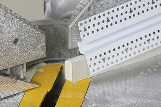 Use a cutoff piece of drywall as a support for the Reveal Bead.